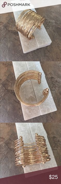 💛Hammered Gold Plated Cuff Individual gold plated hammered wire wrapped into one adjustable cuff. LOVE THIS PIECE. Very Subtle Statement Jewelry