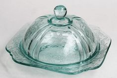 teal-color, covered butter dish