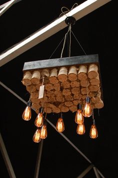Custom Big Daddyu0027s Antiques light fixture made from boxed bed springs and Edison  bulbs.