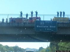 The ashes of Sean Misner, one of the 19 firefighters who died last week in Arizona, were being transported by his wife back to their hometown on Tuesday. She was in his truck and is pregnant with their unborn child. On every overpass for nearly 500 miles there was a tribute similar to this. Pretty damn remarkable!