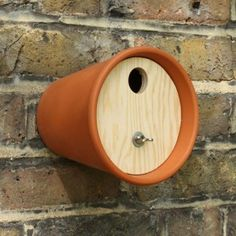 Birds Nest Box. There's already a hole in the bottom of the pot to attach the nest to a wall, tree, or pole. Nifty idea! by All Lovely Stuff.