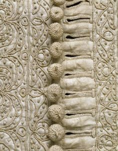 Buttons from a doublet c. 1635 Linen thread, hand plaited and sewn over a wooden core in a technique known as passementerie, forms the decorative buttons. Historical Costume, Historical Clothing, Textiles, Lesage, Passementerie, Linens And Lace, Doublet, Antique Clothing, Fabric Manipulation