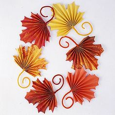 for Fall: Fan-Folded Leaves for Kids to Craft for Thanksgiving Kids will enjoy making these colorful paper leaves for Thanksgiving or harvest decorating. Scatter leaves on a table or wrap the stems around heavy cording to make a pretty garland. Thanksgiving Crafts For Kids, Autumn Crafts, Thanksgiving Decorations, Holiday Crafts, Thanksgiving Table, Harvest Crafts, Fall Decorations, Fall Leaves Crafts, Fall Paper Crafts