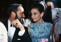 """The actress Audrey Hepburn photographed with her husband Mel Ferrer at the Théâtre du Châtelet, located at Place du Châtelet, in the 1er arrondissement of Paris, during the French premiere of her new movie """"My Fair Lady"""", on December 22, 1964"""