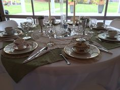 Vintage tea cups, linens, silver and glass.  What a beautiful table setting.  Silver, glass, vintage tea cups, succulents.