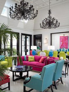 Colourful Interior love the use of color with the white walls and the black chandiliers