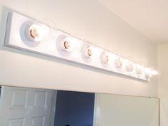Update a Hollywood Brass Light Fixture w/Spray Paint Painting Light Fixtures, Vanity Light Fixtures, Bathroom Vanity Lighting, Bathroom Fixtures, Kids Lighting, Strip Lighting, Painting Kids Furniture, Painting Walls, Light Fixture Makeover