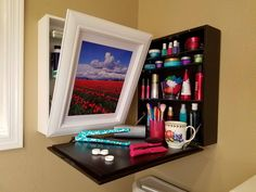 I got an email recently from Johanna Paige, a grade school PE teacher who invented a nifty solution to counter-less bathrooms. A mix between a medicine cabinet and a table, this wall-mounted organi…