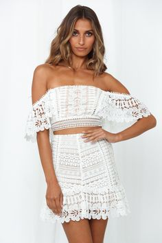 Tailor-made for the babes who love the finer things in life, the Summer Sounds Crop & Skirt Set elevates any weekend edit from a level four to an eleven! Made from lush and delicate crochet lace, this stunning top ticks off every bock for unending feminine style with its ruffle sleeves and off-the-shoulder neckline, and contrasting lining. Team with its matching skirt. #hellomolly #top #crop #white #laces #embroidery #offshoulders Cruise Outfits, White Skirts, Feminine Style, Ruffle Sleeve, Knit Cardigan, Trendy Outfits, Off Shoulder Blouse, Skirt Set