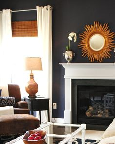 INSPIRATION:  Dark blue walls, white linen/cotton panels, woven roman blinds, white couch, leather chair, brass/gold accents.