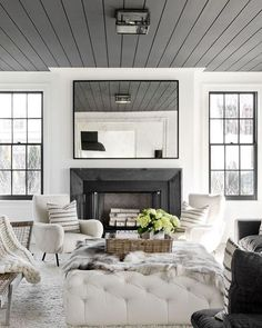 Keeping it monochromatic and modern is clearly a good idea! This living room by @TamaraMagelDesign boasts charcoal grey painted window trim and shiplap ceiling, creamy white furnishings with wool and wicker accents to strike just the right balance between cool and cozy. (image via @coco.kelley, photography by @RikkiSnyder) #getinspired