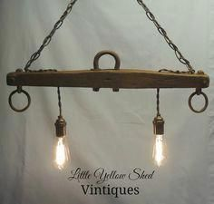 Repurposed Horse Yoke turned Hanging Light using Edison bulbs. Check out my website at Little Yellow Shed Vintiques to see more pictures. Like Littl Farmhouse Lighting, Rustic Lighting, Industrial Lighting, Vintage Lighting, Kitchen Lighting, Hanging Light Fixtures, Hanging Lights, Hanging Lamps, Western Decor