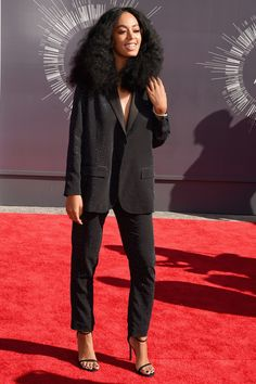 The 11 Must-See Looks At The VMAs #refinery29 http://www.refinery29.com/2014/08/73263/best-dressed-mtv-video-music-awards-vmas-2014#slide4 Solange Knowles Abandoning her usual penchant for prints, Knowles opted for a boxy, black sequined pant suit from H&M (yes, H&M!) — a move so shocking that we almost didn't recognize her. Side note: We love the Diana Ross-inspired hair.