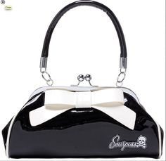 A classy bag for a classy dame. The Patent leather & delicate white bow says lady all over it. Perfect for date night. BLACK & WHITE FLOOZEY PURSE BY SOURPUSS