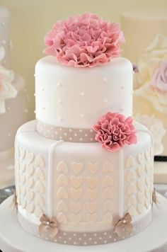 cake with chevron pattern in the hearts. Good for a heart themed wedding for sure. Although its so very girly I don't know how much the groom may have had to say in the cake decision!