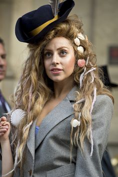 Lady Gaga stuck with the nautical theme, adding a pirate's hat and seashells to this wig. We consider her Ariel fantasy fulfilled. Lady Gaga Wig, Lady Gaga Artpop, Dreads, Pirate Hair, Lady Gaga Fashion, Ladies Fashion, Fashion Fashion, Lady Gaga Pictures, Pirate Woman