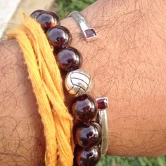 Garnet and silver beads and silver wrist band with red ruby colour spinel