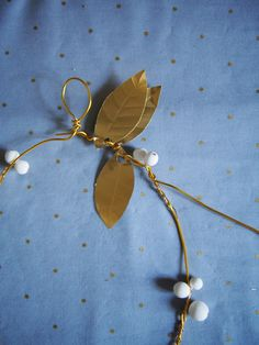 garland with clay berries and gold leaves. This one is a wreath but could be used for bridal
