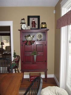 love the cupboard design and color