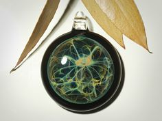 Earth Energy Pendant   Hand Crafted in our Small Island Studio, on Salt Spring Island, BC Canada.   #spacependant #glassjewelry #blownglasspendant #cosmicglass #neurons #glassnecklace #uniquegifts #christmasideas #galaxyfilaments