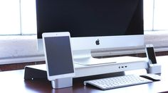A sleek, multifunctional iMac and Apple display stand that raises your monitor for ergonomics and also serves as a device docking and charging station.