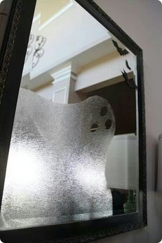 Use press n seal contact paper on mirror to make ghost for Halloween