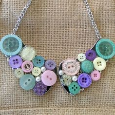 A beautiful one of the kind button necklace with Aqua and pastel tones.Matching earrings available.
