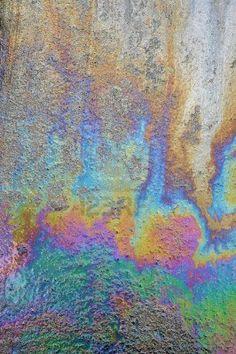 Oil spill on asphalt road - Stock Photo