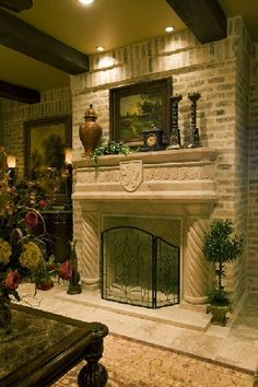 handcarved solid travertine fireplace in combination with light brick, dark beams