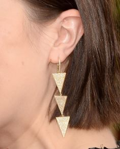 Elisabeth Moss dazzled in Jennifer Meyer's Triple Triangle Earrings on the red carpet for the 71st Annual Golden Globe Awards held at The Beverly Hilton Hotel on January 12, 2014 in Beverly Hills.