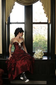 A satin red wedding dress with ankle high black converse trainers. A very cool look for a very cool Halloween themed wedding Punk Wedding, Gothic Wedding, Red Wedding, Elegant Wedding, Wedding Castle, Medieval Wedding, Nontraditional Wedding, Burgundy Wedding, Wedding Hair