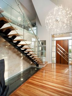 Greet Your Guest with Dazzling Foyer Chandeliers: Cool Contemporary on split foyer entry way wall ideas, small entryway lighting ideas, foyer lighting ideas, modern foyer chandelier lighting,