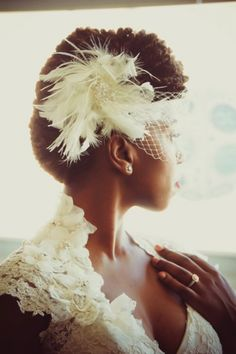 Natural haired bride with a vintage inspired updo and feather fascinator and veil by Takiyah Wallace of Some Sweet Photo