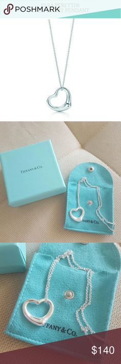 Tiffany & Co. open heart pendant Authentic Tiffany & Co. Elsa Peretti open heart pendant and chain (sterling silver).  Just recently cleaned at the Tiffany & Co. store in Honolulu on 10/31/16.  Great condition. Comes with pouch and box.   Please make any offers through the offer feature. Sorry no trades. Thank you! =) Tiffany & Co. Jewelry Necklaces