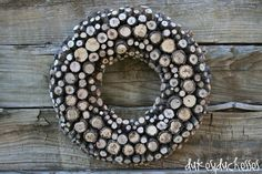 DIY- A Log {or Branch} Wreath. I don't know if I have the patience to DIY this,but I do think it's beautiful!