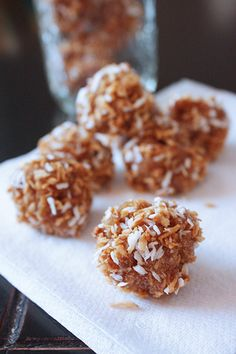 dirty snowballs  2 cups coconut sprinkles*, divided  roughly 1 1/2 cups peanut butter  1 ripe banana  a few tablespoons shredded coconut (for rolling)