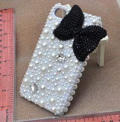 Bling black bow phone cover pearl phone case for iPhone4/4S (iPhone 5 case accept custom). $19.90, via Etsy.
