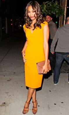 these tan accessories work so well with this mustard shade