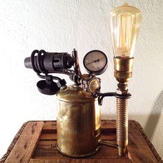 "Steampunk lamp ""Doc Tesla"". Made from a large, exklusive Primus Blowtorch, combined with an vintage gauge and a Edison Style Bulb."