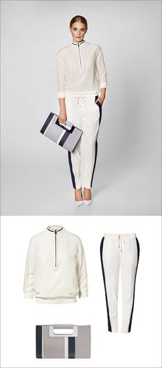Women's Fashion Ideas - 12 Womens Outfits From Porsche Design's 2017 Spring/Summer Collection // This women's outfit made up of a white blouse, white pants with a navy stripe, and a simple grey and navy clutch, is perfect for a casual spring outing.