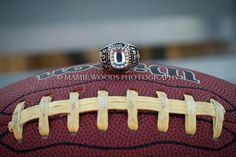 Football senior picture with class ring\ maybe use a basketball or soccerball instead?