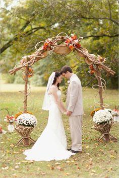 rustic outdoor wedding ceremony #rusticwedding #outdoorwedding #weddingchicks http://www.weddingchicks.com/2014/02/07/red-and-orange-fall-wedding/