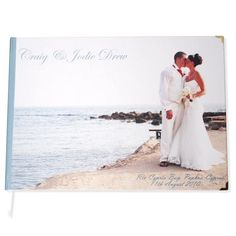 Print a large photo of the couple and have everyone sign it in a blank spot.