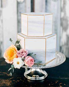 Wedding Cake Design Ideas That'll Wow Your Guests | Martha Stewart Weddings - This modern, marble-inspired wedding cake stunned with a floral cake topper and gilded edges. #weddingcakes #weddingideas #modernweddingcakes