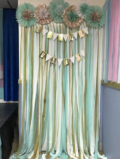 Easy photo booth backdrop!! Made from plastic table clothes and tissue paper flowers. Banner can be made too or bought cheap! With sticker letters to make whatever word.