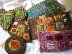 Would never have thought of turning Harris tweed into these Klimt-y little dazzlers... interesting take on it.