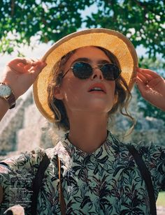 straw boat hat + circle sunnies + simple watch + backpack + printed button-up shirt (TOP BUTTON)