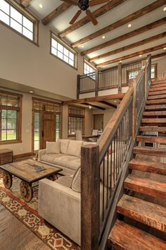Country Staircase with Country wagon coffee table, Hardwood floors, Exposed beam, Loft, Microsuede sofa, Paint