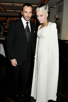Tom Ford's London Dinner Party~  Tom Ford & Daphne Guinness, in a dress by the designer.
