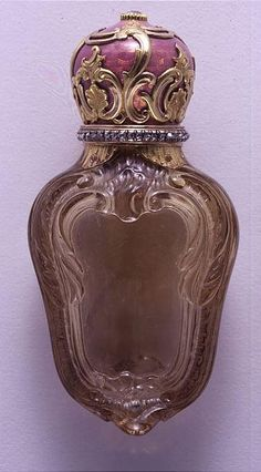 A fine and rare Faberge carved smokey quartz, gold, enamel and jewelled scent flask, workmaster Michael Perchin, St.